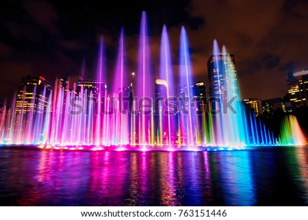 the colorful fountain on the lake at night near by twin towers stock photo © galitskaya