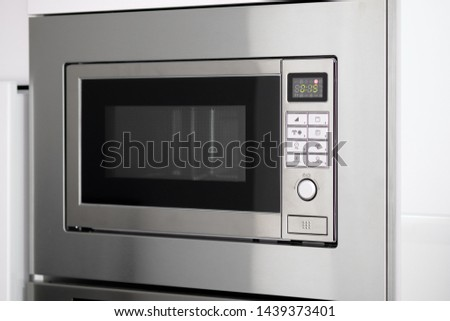 close up of modern microwave oven front view grey color contemp stock photo © amok