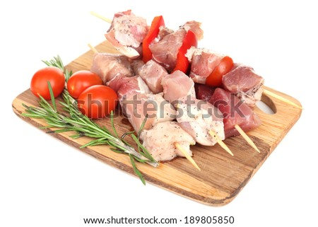raw pork and chicken kebab with paprika on chopping board with fresh vegetables and disposable charc stock photo © denismart