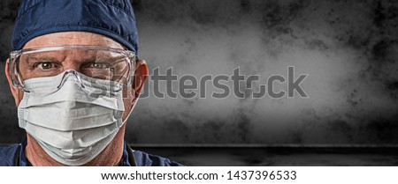 Male Doctor or Nurse Wearing Goggles and Face Mask Against Grung Stock photo © feverpitch