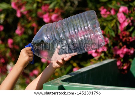 close up hands of child little kid holding empty big water plast stock photo © amok