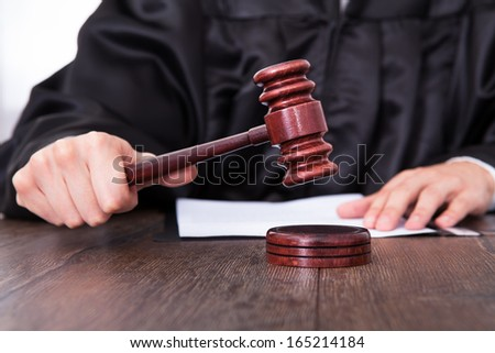 Close up of hand, Judge hitting gavel on wooden table and workin Stock photo © Freedomz