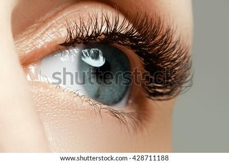 Female eye with long eyelashes close up. Closeup shot of female  Stock photo © serdechny