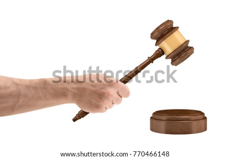 male lawyer or judge hands striking the gavel on sounding block stock photo © freedomz