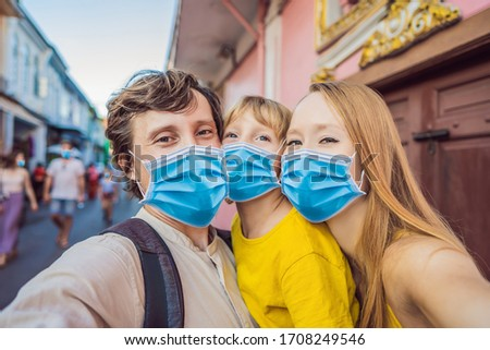 Mom and son tourists on the Street in the Portugese style Romani in Phuket Town. Also called Chinato Stock photo © galitskaya