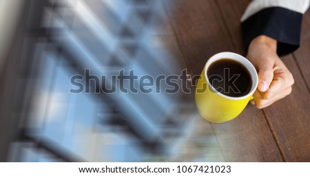 Overhead of hand with yellow coffee cup and blurry window transition Stock photo © wavebreak_media