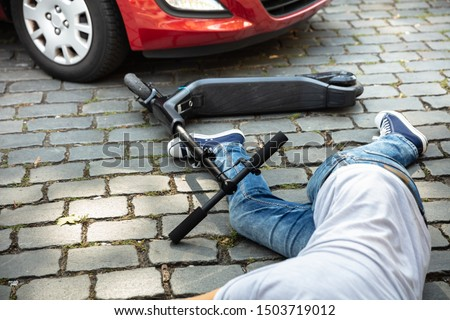 Unconscious Man Lying On Street After Accident Electric Scooter Stock photo © AndreyPopov