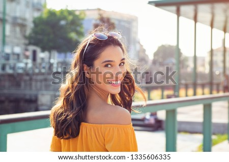 Woman enjoying happiness and freedom while walking on a tropical beach Stock photo © Kzenon