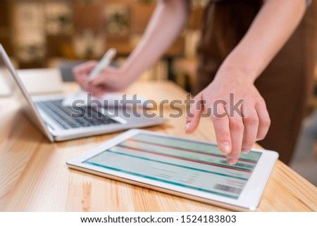 hand of female employee pointing at electronic document on touchpad display stock photo © pressmaster