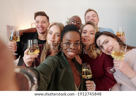 Group of young intercultural friends in casualwear making high-five Stock photo © pressmaster