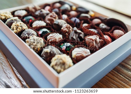 various snacks in vintage wooden box on black background onion ringsnachos salty peanuts with pot stock photo © denismart