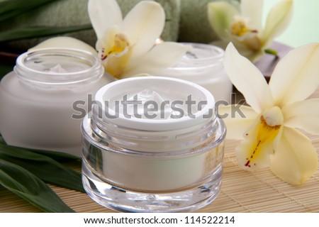Face cream moisturizer jar and orchid flower, moisturizing skin  Stock photo © Anneleven