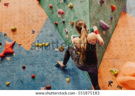 attractive young professional sport climber woman having training in the gym at artificial wall Stock photo © galitskaya