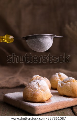 Process of decorating with icing sugar profiteroles. Rustic style. Stock photo © Illia