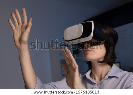 Young female employee with vr headset making virtual presentation Stock photo © pressmaster
