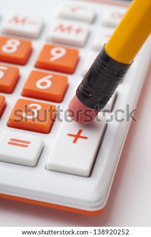 The pencil eraser and the add button in the calculator isolated on blue stock photo © johnkwan