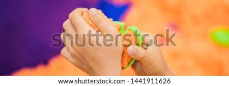 Chłopców ręce gry pomarańczowy piasku banner Zdjęcia stock © galitskaya