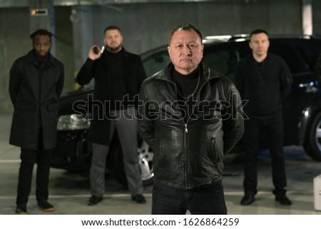 Maduro criminal autoridad negro chaqueta de cuero manos Foto stock © pressmaster