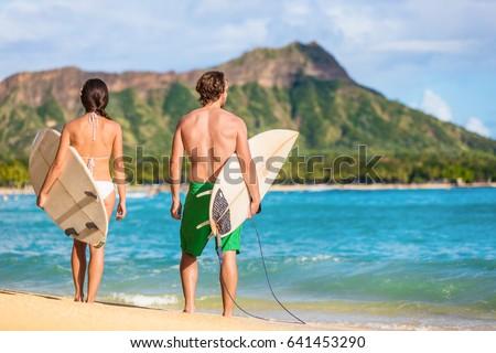 Hawaii surfers people relaxing on waikiki beach with surfboards looking at waves in Honolulu, Hawaii Stock photo © Maridav
