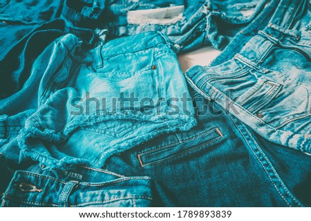 Jeans fast fashion textile industry tons of pairs of pants produced every year going to waste. Close Stock photo © Maridav