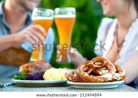 two laughing bavarian girls with beer and pretzels on the floor stock photo © Rob_Stark