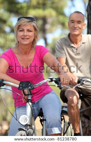 60 years old blonde woman is contemplating landscapes with binoculars, she's wearing warm clothes an Stock photo © photography33