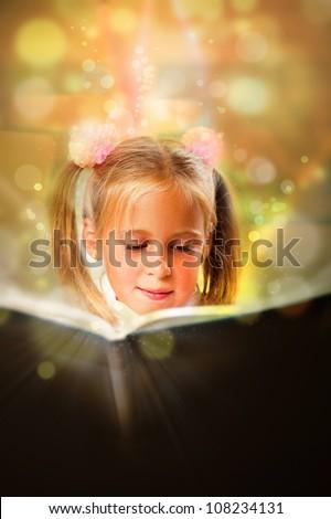 Image of smart child reading interesting book in classroom. Vert Stock photo © HASLOO