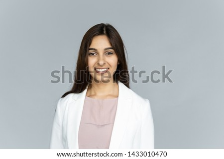 Stock photo: Closeup portrait of young pretty woman wearing formal suit erasi