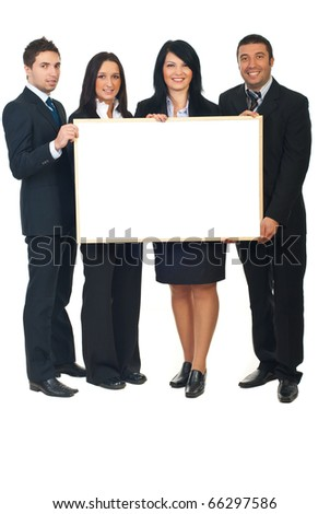 Four young executives holding a blank presentation board behind their boss Stock photo © photography33