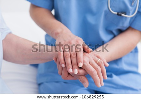 Close up of a nurse touching hand of a patient in hospital ward stock photo © wavebreak_media
