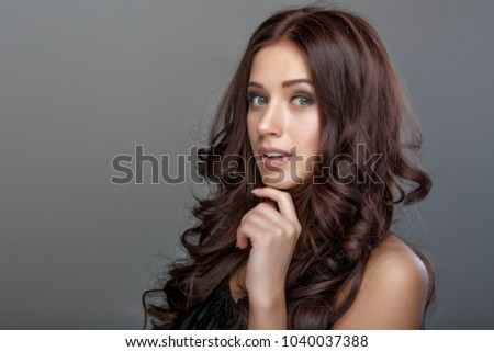 Fashion girl model, brunette woman with shiny curly silky hair i Stock photo © Victoria_Andreas