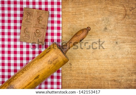 Rolling pin with mold on a wooden board with a checkered tablecloth Stock photo © Zerbor