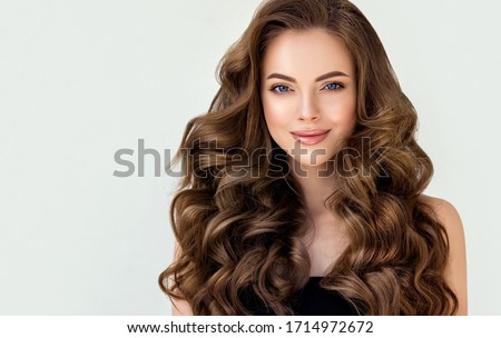 Brown hair styling. Brunette girl with curly hairstyle with barr Stock photo © Victoria_Andreas