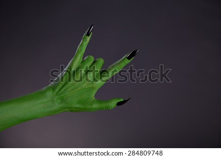Green Monster Hands With Black Nails Showing Heavy Metal Gesture Photo stock © Elisanth