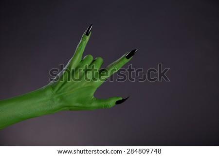 sápadt · szörny · kezek · mutat · nehézfém · szimbólum - stock fotó © elisanth