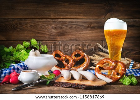 bavarian veal sausages on a plate with beer, pretzel and towel Stock photo © Rob_Stark