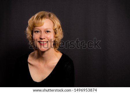 Happy woman in her 40s styling short hair curls on her friend Stock photo © lubavnel
