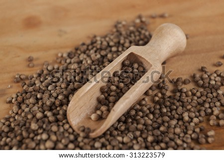 Coriander seeds with a wooden spoon on a small wooden tray. Beautiful photos of culinary magazines Stock photo © mcherevan