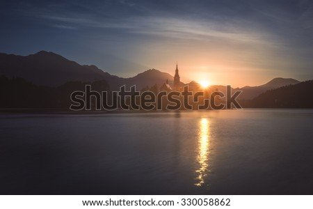 silhouette of little island with catholic church in bled lake s stock photo © kayco