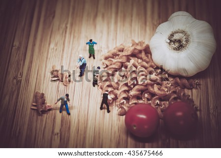 Miniature people collect ingredients to cook pasta. Color tone t Stock photo © Kirill_M
