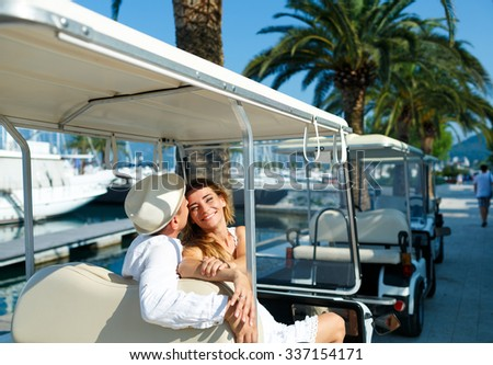 Couple driving electric car on the marina on a luxury waterfront Stock photo © vlad_star