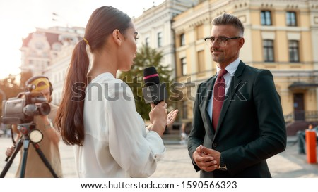reporters making interview with businessman or politician news conference stock photo © wellphoto