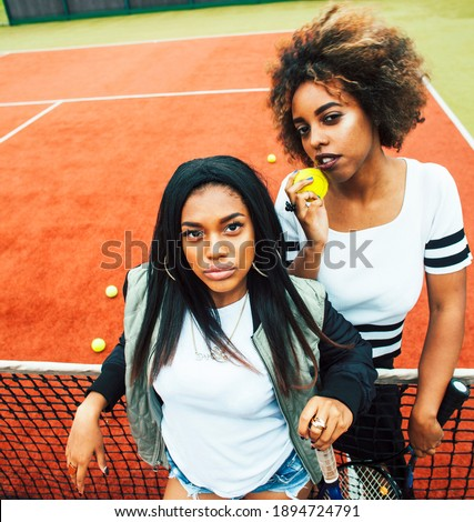 young pretty girlfriends hanging on tennis court fashion stylish dressed swag best friends happy s stock photo © iordani