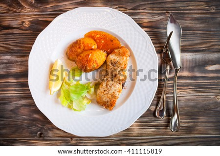 grilled fish with potatoes slice of lemon and red sause on wood stock photo © yatsenko