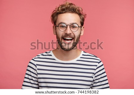 young handsome teenage hipster guy posing emotional happy smiling against white background isolated stock photo © iordani