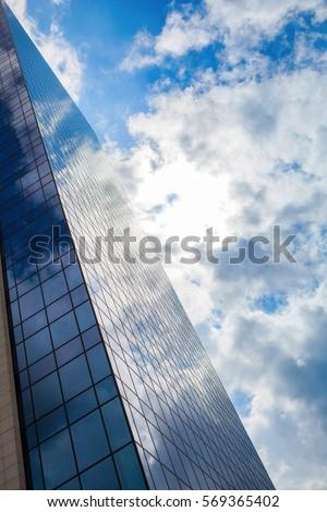 nuvens · reflexão · prédio · comercial · nublado · céu · vidro - foto stock © artjazz