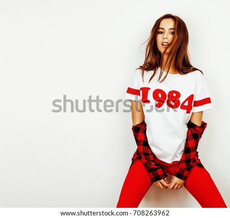 young pretty teenage hipster girl posing emotional happy smiling on white background, lifestyle peop stock photo © iordani