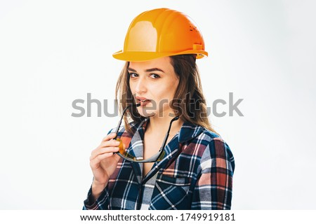 Young builder girl in chechered shirt, glasses and white shorts  Stock photo © Traimak