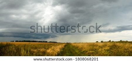 Stock photo: Dark cloud storm. Rain coming on the sky in the rural road view.