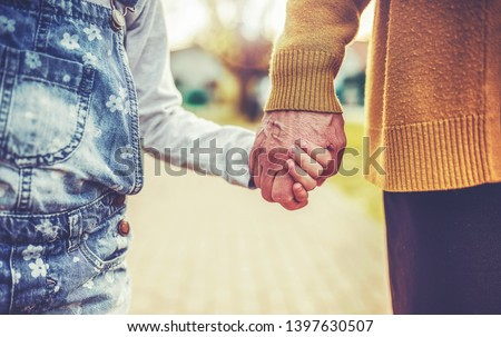 grandparents and grandchildren holding hands walking on beach stock photo © is2
